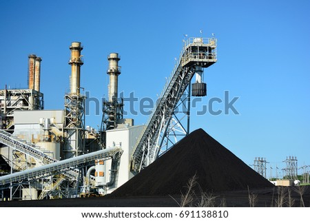 Coal Power Plant and a Large Pile of Coal