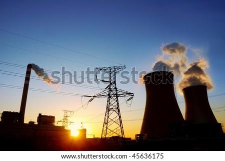 Coal power plant at sunrise