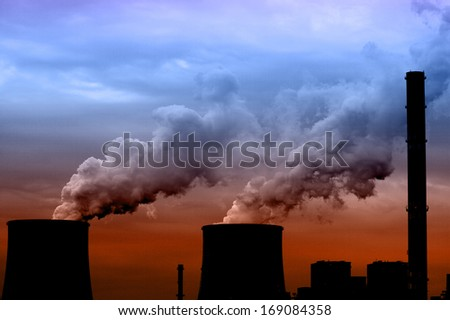 Coal power plant with chimney and cooling towers