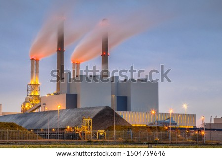 Coal powered electicity power plant in Europoort area with supply in foreground, Maasvlakte Rotterdam Netherlands