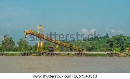 coal stockpile on upper Mahakam riverbank, Indonesia #1067543318