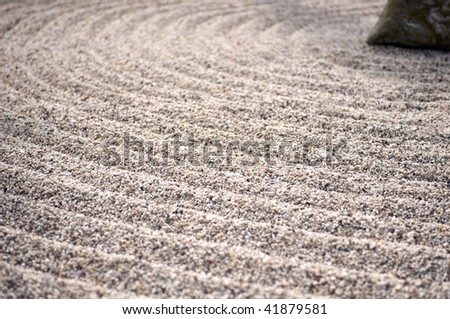 Coarse gravel raked into circles around a rock in large for Formal japanese garden