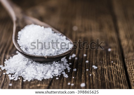 Coarse Salt (selective focus; close-up shot) on a dark vintage background
