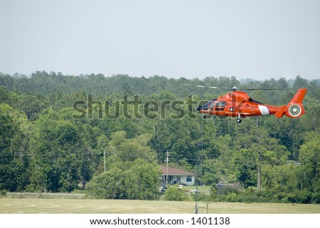 Coast Guard HH65 helicopter in flight low pass