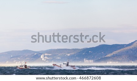 Coast Guard in storm and heavy wind . In background Miramar Castle #466872608