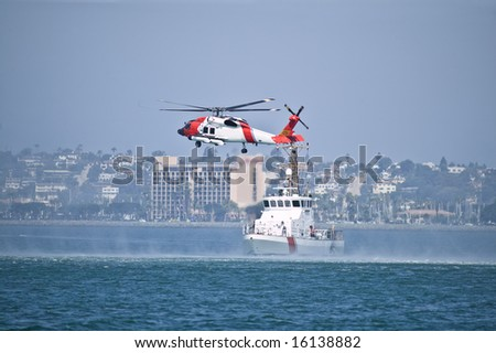 Coast Guard Jayhwak Helicopter hovering over search and rescue boat