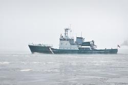 Coast guard ship sailing during the storm. Winter. Fog, waves, rough weather. Baltic sea. Transportation, nautical vessel, international security, global communications, border control, customs