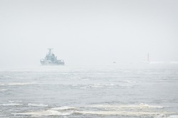 Coast guard ship sailing during the storm. Winter. Fog, waves, rough weather. Baltic sea.