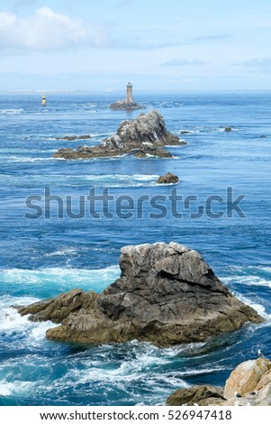 Coast in Brittany, with cliffs at the top of cliffs, Rocky promontory Pointe du Raz #526947418