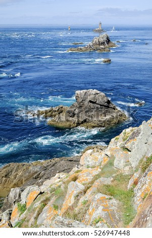 Coast in Brittany, with cliffs at the top of cliffs, Rocky promontory Pointe du Raz #526947448