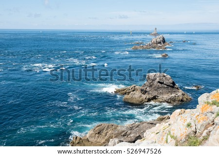 Coast in Brittany, with cliffs at the top of cliffs, Rocky promontory Pointe du Raz #526947526