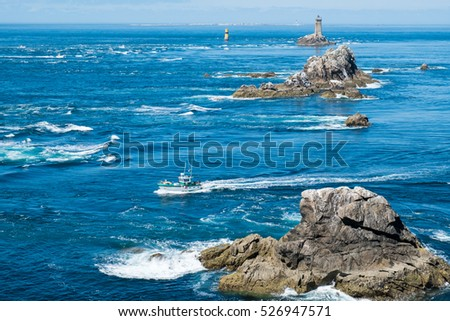 Coast in Brittany, with cliffs at the top of cliffs, Rocky promontory Pointe du Raz #526947571