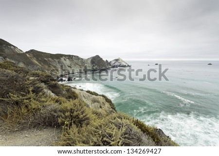 Coast of Big Sur with cloudy sky. USA. California.