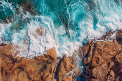 Coast of desert island with blue turquoise water beats on rocky reef Malta. Aerial top view