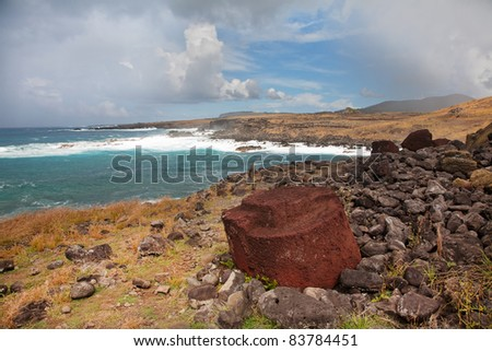 Coast of Easter island with some broken statues - stock photo