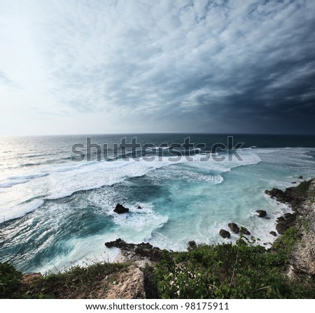 Coast of Indian ocean with waves and cloudy sky. Bali, Indonesia #98175911