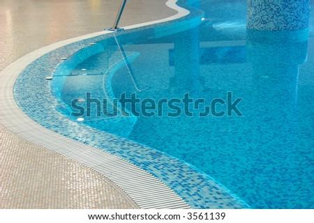 coast of swimming pool in fitness club