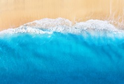 Coast with waves as a background from top view. Blue water background from drone. Summer seascape from air. Travel - image