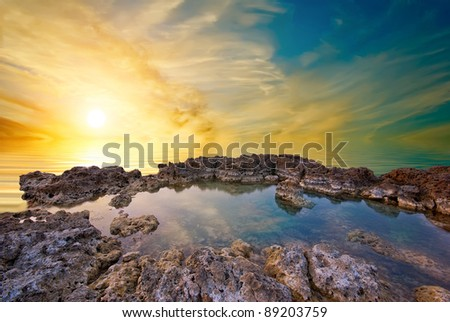 Coastal cliffs, the bay and natural sea sunset
