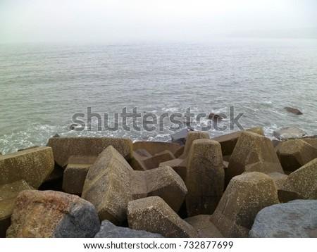 Coastal erosion protection rock armour sea defence #732877699