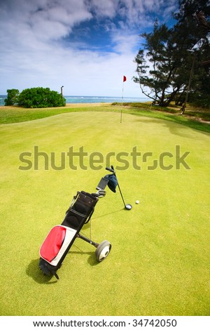 Coastal Golf Course. Golf clubs in bag and ball on a beautiful golf course