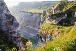 coastal landscape along the Falaise d'Aval the famous white cliffs of Etretat village, Normandie France