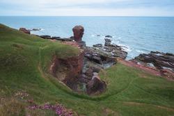 Coastal landscape of the Deil's Heid (Devil's Head) red sandstone sea stack at Seaton Cliffs at Arbroath east coast of Angus, Scotland.