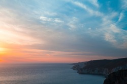 Coastal landscape with dramatic sky at sunset. Cape Keri in Greek island Zakynthos, Ionian Sea