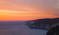 Coastal landscape with dramatic sunset. Cape Keri in Greek island Zakynthos, Ionian Sea
