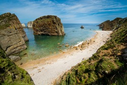 Coastal landscape with giant rocks on an unspoiled beach in Asturias, Spain.