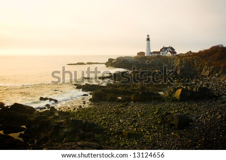 Coastal scene in early morning with a lighthouse
