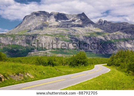 Coastal tourist road in Norway with picturesque view of mountains