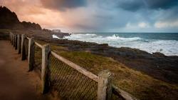 Coastal view with waves crashing on rocks