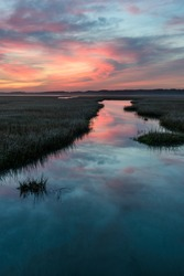 Coastal Wetlands with Dramatic Sunrise