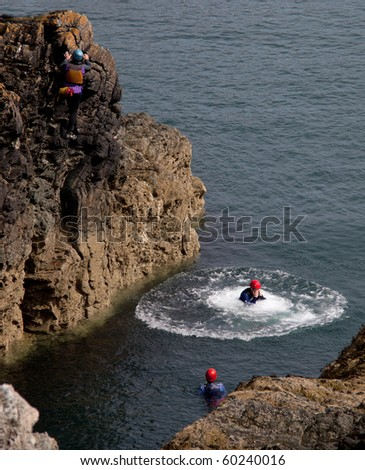 Coasteering where organised groups jump off cliffs into the sea The Range Isle of Anglesey