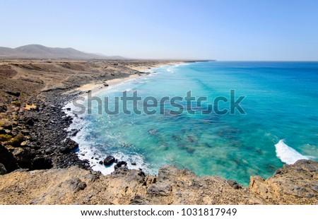 Coastline near El Cotillo village on Fuerteventura island on the sunset in Spain. Canary Islands. #1031817949