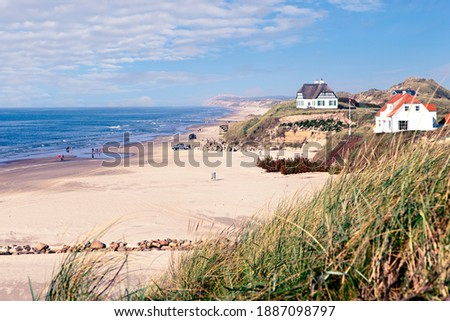 Coastline with summerhouses at the Danish west coast near Loekken. One of few places where driving on the beach is permitted Сток-фото ©