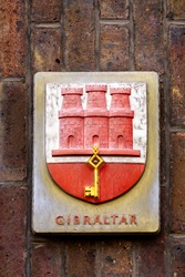 Coat of arms of Gibraltar, granted in 1502 by Isabella of Castile, featuring a red castle under which a golden key hangs