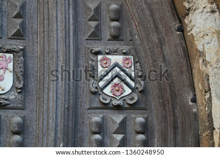 Coat of arms of New College Oxford one of the constituent colleges of the university on the Great Gate to the Bodleian library also the emblem of William of Wykeham who founded the college