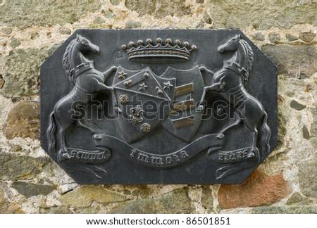 Coat of arms of the Vorontsov family on a wall of the Vorontsovsky Palace, Alupka, Crimea, Ukraine.