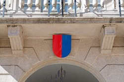 Coat of arms of Ticino Canton hanging at the entrance of Government building also know as Palazzo delle Orseline in Bellinzona, Switzerland