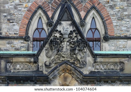Coat of Arms sculpture above the entrance of East Block Parliament Buildings, Ottawa, Canada