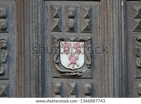 Coat of arms with three eagles of The Queen's College Oxford founded for Philippa of Hainault one of the constituent colleges of the university carved on the Great Gate to the Bodleian library quad