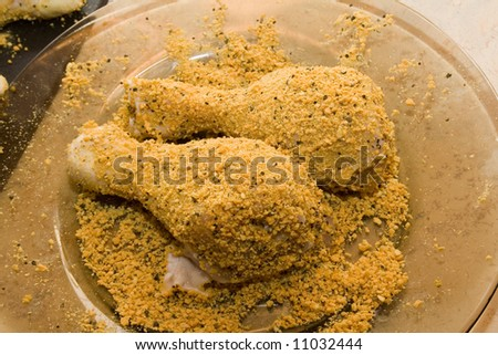 coated raw chicken drumsticks