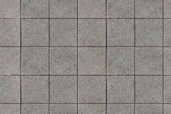 Coating with modern textured paving tiles of square shape.