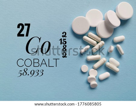 Cobalt is a chemical element of the periodic table with the symbol Co and atomic number 27. The symbol Co with atomic data (atomic number, mass and electron configuration) and pills in the background.