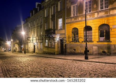 Cobbled Mostowa street at night in the New Town, an old district in Warsaw, Poland.