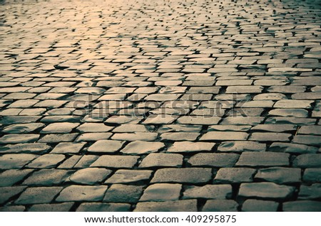cobbled road as background #409295875