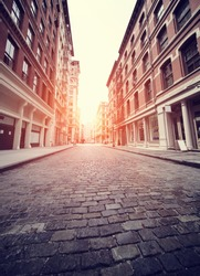 Cobbled Soho street in New York with added sun effect and Instagram filter