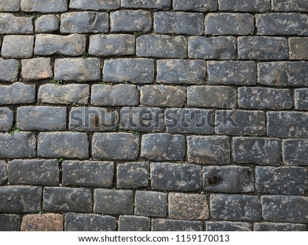 Cobbled stones pattern Paving stone vintage road cover in a historical place